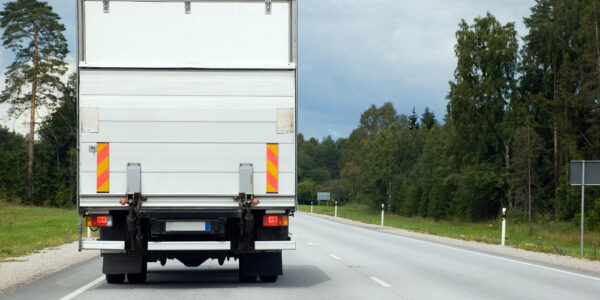 On The Road - White Cargo Van Transporting Goods